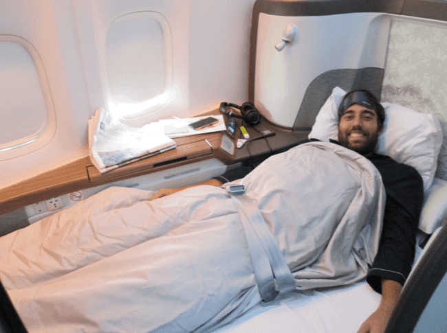 Scott flying Cathay Pacific First Class.